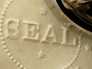 close up of embossed seal on paper